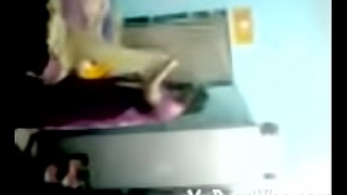 busty-telugu-aunty-changing-dress-caught-topless-hidden-cam-mms